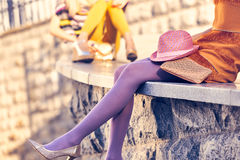 Fashion urban people, womans,outdoor. Lifestyle. Fashion urban beauty people friends,outdoor.Womens legs, pantyhose, stylish shoes, clutches.Playful hipster stock photo