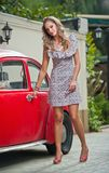 Fashion urban portrait of beautiful model with long legs on the street. Blonde Girl with short dress Royalty Free Stock Photo