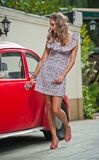 Fashion urban portrait of beautiful model with long legs on the street. Blonde Girl with short dress Stock Photography