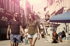 Fashion, urban style, lifestyle. Couple secrets fantasy. Fashion, urban style, lifestyle. Sexy women and bearded men hold hands on street, love. Couple in love Stock Image