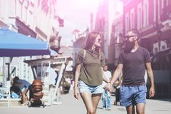 Fashion, urban style, lifestyle. Sexy women and bearded men hold hands on street, love. Couple in love on summer vacation. Love, relations, couple, romance stock photo