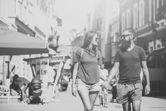 Couple in love. Fashion, urban style, lifestyle. Fashion, urban style, lifestyle. Sexy women and bearded men hold hands on street, love. Couple in love. Couple Stock Photo