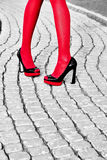 Fashion urban womens legs, heels. Black white, red Stock Images