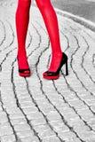 Fashion urban womens legs, heels. Black white, red Royalty Free Stock Photo