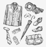 Fashion. Vector collection of men clothing. Hand-drawn sketch umbrella, tie, shoes, glasses, gloves, bag, scarf, jacket. Fashion. Vector collection of men Stock Image