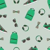 Fashion vector seamless pattern backpacks, sunglasses stock illustration