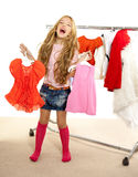 Fashion victim kid girl at backstage wardrobe Stock Image