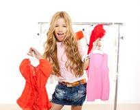 Fashion victim kid girl at backstage wardrobe Stock Images