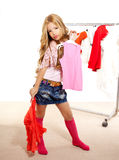 Fashion victim kid girl at backstage wardrobe Royalty Free Stock Photography