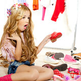 Fashion victim kid girl wardrobe messy backstage Stock Image
