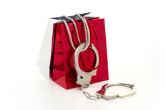 FASHION VICTIM. Two glamorous shopping bags got 'arrested' with handcuffs Stock Photos