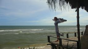 Fashion video portrait of a girl on the sea stock video footage