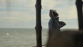Fashion video portrait of a girl on the sea stock video