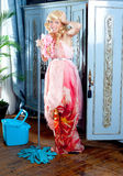 Fashion vintage blond housewife cleaning. Fashion vintage blond housewife with mop cleaning chores at home Stock Photo