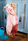 Fashion vintage blond housewife cleaning mop. Fashion vintage blond housewife with mop cleaning chores at home Royalty Free Stock Images