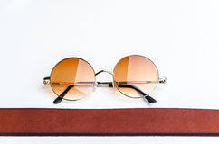 Fashion of vintage glasses and brown belt Royalty Free Stock Photo