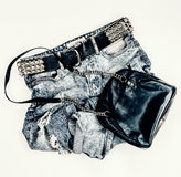 Fashion vintage jeans with black leather bag Royalty Free Stock Photos