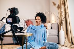 Fashion vlogger reviewing new clothes royalty free stock image