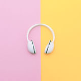 Fashion white headphones on vanilla background Stock Photo