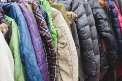Fashion winter coats hanged on a clothes rack.  royalty free stock photos