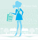 Fashion winter girl with shopping bags Royalty Free Stock Images