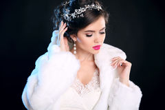 Fashion Winter portrait of beautiful girl  in white Fur Coat. Ma Stock Image