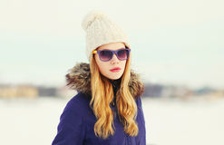 Fashion winter portrait blonde woman wearing jacket knitted hat sunglasses Stock Photography