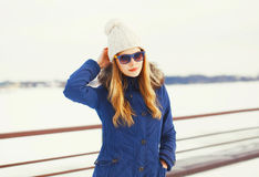 Fashion winter portrait pretty blonde woman wearing jacket hat sunglasses Royalty Free Stock Photography
