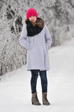 Fashion winter woman. Presents winter clothes in a snowy day Royalty Free Stock Photos