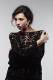 Fashion woman. Fashion portrait of a beautiful woman in knitted dress isolated Royalty Free Stock Photo