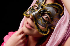 Fashion woman. With pink scarf and carnival mask on black background Royalty Free Stock Photo