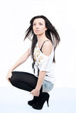Fashion woman. Beautiful brunette girl looking up on white background Stock Photo
