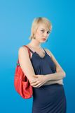 Fashion woman. Pretty fashion woman  posing with red purse Royalty Free Stock Photo