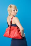 Fashion woman. Pretty fashion woman posing with red purse stock image