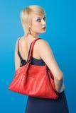 Fashion woman. Pretty fashion woman posing with red purse royalty free stock image
