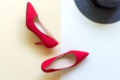 Fashion woman accessories set. Trendy fashion red shoes heels, back big hat. Stock Image