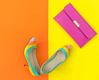 Fashion woman accessories set. Trendy fashion shoes heels, stylish handbag clutch. Colorfull background.