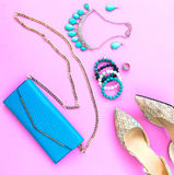 Fashion woman accessories set. Trendy fashion shoes heels, stylish handbag clutch, necklace, bracelet and ring. Stock Photos