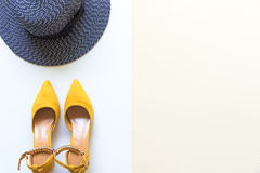 Fashion woman accessories set. Trendy fashion yellow shoes heels, stylish big hat. Colorfull background. Royalty Free Stock Photos