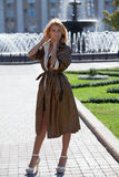 Fashion woman in autumn coat near the fountain Stock Images