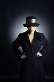 Fashion woman in autumn dress clothes. Fashion woman in black hat and coat. Portrait of pretty woman in autumn dress Royalty Free Stock Image