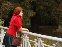 Fashion woman  in autumn park Stock Images