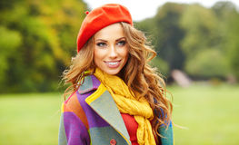 Fashion woman in autumn park Royalty Free Stock Photo