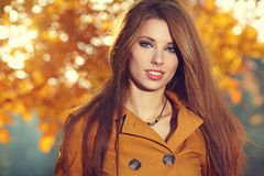 Fashion woman in autumn park Royalty Free Stock Photos