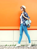 Fashion woman with backpack over colorful orange Stock Photography