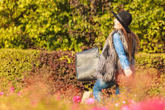 Fashion woman with bag outside Royalty Free Stock Photo