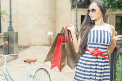 Fashion woman with bags and bike, shopping travel to Italy Royalty Free Stock Photos