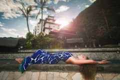 Fashion woman at Balinese Hotel, luxury resort and spa. royalty free stock photography