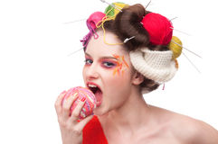 Fashion woman with ball. Closeup portrait of beautiful fashion woman with color face art. All in knitting style. Wool balls. Bite Royalty Free Stock Image
