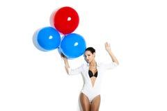 Fashion woman with ballons Stock Photos